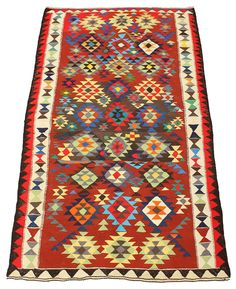 - A Harsin Kilim, embellished with repeating pattern and hooked medallions in colours. century second half. 306 x 172 cm.