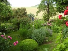 GardenDrum UFeistel garden to the south of the house dominated by colour from peonies & roses