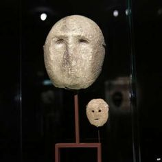A 9,000 year-old mask is on display at the Israel Museum in Jerusalem on 10 March 2014.