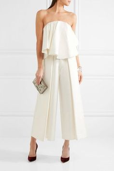 Solace London's lustrous ivory satin strapless jumpsuit is trimmed with a fluted asymmetric overlay at the front - we like how the structured internal corset creates a flattering slim silhouette at the back. The wide-leg pants feature sharp pleats for added volume. It has a cropped cut that works especially well with heels.