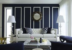 I absolutely love navy blue walls! This is a classic contrast of navy and white.