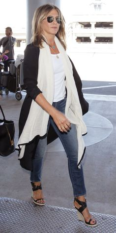 Flying out of town this weekend? Take a page out of Jennifer Aniston's book and accent your travel look with an elegant blanket wrap—you'll thank us when the plane's air conditioning revs up!