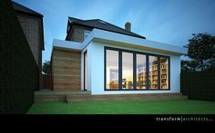 Contemporary single storey grass roof extension