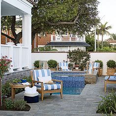 On the ocean-facing side of the house, a raised spa spills into a petite dipping pool. CoastalLiving.com