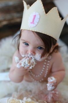 First birthday. I think I like the crown better than the bday hat. ~c