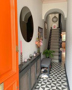 Patterned tiles in the hallway and a splash of orange on the front door helps to create a scene-stealing entrance. Neutral Hallway, Hallway Colours, Victorian Homes, Hallway Flooring, Hall Tiles, Small Entrance, Tiled Hallway, Narrow Hallway Decorating, Door Color