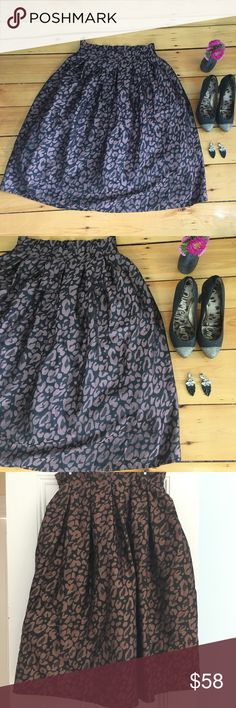 ASOS Sold Out Leopard Print Paper Bag Waist Skirt Beautiful animal print skirt and a silky fabric with texture. Grayish pink with light grey-ish black shiny beautiful fabric. Layers of taffeta add volume and flowers for the scare and make it extra elegant and special. ASOS brand in fabulous pre-loved condition (like new)  with no issues to note.  Please see additional photos for measurements. Open to reasonable offers is in the offer button. Auto save 15% on 2+ items. But I know your likes…