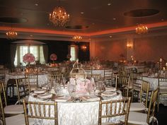golden wedding reception - pink and white wedding, pink lighting, gold plates | event center at blue