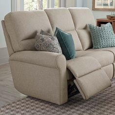 Bedford Motion Sofa by Bassett Furniture.  Each end seat of the sofa reclines while the center seat is stationary.