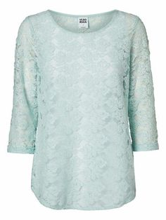 Delicate lace shirt in pretty pastel hue.