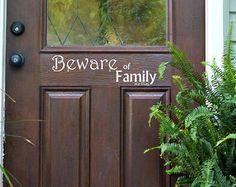 "Front Door Decor ""Beware of Family We Hug""  Decal - Home Decor Vinyl Lettering DecalHousewarming Gift Idea"