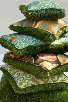 Reversible Outdoor Pillows....one side pretty print fabric and the other side looks like grass.