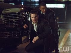 "Arrow -- ""Vertigo"" -- Image AR112a_2595bc – Pictured (L-R): Stephen Amell as Oliver Queen and David Ramsey as John Diggle -- Photo: Jack Rowand/The CW -- ©2013 The CW Network. All Rights Reserved"