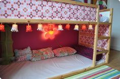 IKEA Reversible Kura bed.  I like the cute hanging lights underneath the bunk bed.