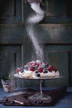 Pavlova dessert with fresh berries by Natasha Breen on Creative Market food photography tips Rustic Food Photography, Cake Photography, Food Photography Styling, Food Styling, Amazing Food Photography, Meringue Desserts, Meringue Pavlova, Meringue Food, Mini Pavlova