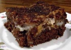 1 cup sweetened flaked coconut... 1 cup pecans, finely chopped 3 1/2 cups powdered sugar 1 cup margarine, melted 8 ounces cream...