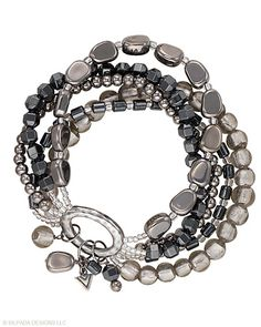"Strands of Sterling Silver, Hematite and Glass Beads are strung together to create this dynamic Stretch Bracelet. Fits up to a 7"" wrist."
