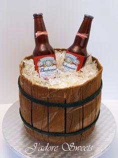 Sugar beer bottle in a barrel cake The sugar beer bottles and sugar ice chips are isomalt. I made my own beer mould using Easy Mold, a m. Beer Bottle Cake, Beer Bottles, Bolo Budweiser, Ice Bucket Cake, Fondant Cakes, Cupcake Cakes, Chocolate Hazelnut Cake, Chocolate Beer, White Chocolate