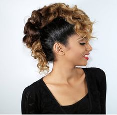 Yes, you can create a faux hawk with long curly hair, check out how Ariba does it here. It's easier than you think.