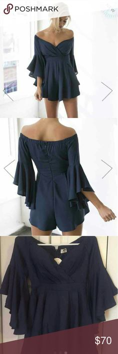 Boho Belle Sleeve Romper This gorgeous navy blue romper has 3/4 length, flared sleeve and an invisible zipper running through the back. Fantastic quality material from Australia. Fully lined. True to size. 100% Polyester. Style yours with some cute suede boots!  Measurements:  Waist: 28 cm Bust: 30 cm and has some stretch  Off the shoulder total length is 60 cm.   I paid full price for this from Australia but didn't end up wearing it for the event I bought it for so it is brand new with…