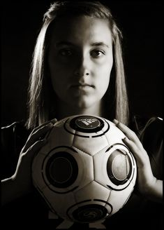 Dramatic lighting from a soccer portrait session.