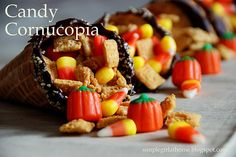 Cornucopia made of waffle cones, melted chocolate, and candy...cute favor!