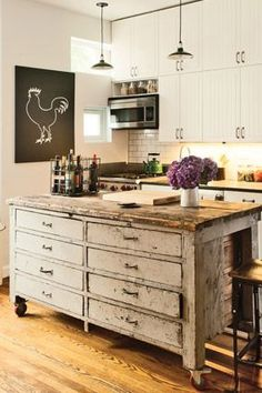 "How to Get the Kitchen of Your Dreams - Rethink Your Island Dreams ""By repurposing a cool piece of vintage furniture, like this armoire, you can make a one-of-a-kind kitchen island and save the antique piece from a landfill."" —Cortney and Robert Novogratz, authors of Home by Novogratz (Artisan Books)"