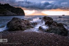 Sunrise on the rocks by GiuseppeTorre  beach beautiful beauty bella blue calm clouds dawn dramatic isola italy light low rise magic morning