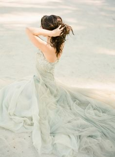 Bride photograph on the beach. Pretty wedding gown in a sea-inspiring color.