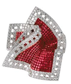 A Van Cleef & Arpels Pochette clip with mystery-set rubies.