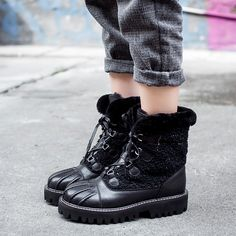 Chiko Nann Fur lined Lug Sole Combat Boots feature round toe, lace up front, fur lined, comfortable lug sole.