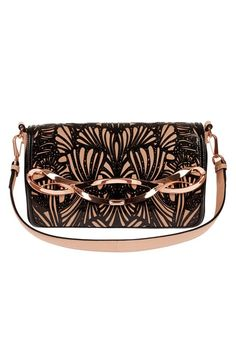 I love this black and nude bag with a nice design in the middle so pretty