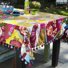 Pretty Boho Tablecloth, gives me the idea to do a table runner with Mexican bobbles on