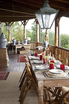 This is how I would like our back porch off the kitchen set for picnics out of the sun of a cool fall dinner enjoying nature!!!