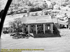 """This aerial view shows us the Tara mansion from """"Gone With The Wind"""" sitting in ruins on the 40 Acres back lot, circa 1959. By this point, it was more than 20 years old, so I'm rather impressed it was still recognizable—considering it was built for one movie, and such things weren't meant to last. And isn't it interesting / odd / disconcerting to see Culver City in the background and not acres of cotton plantation?"""