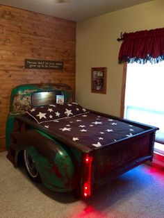 Chevy truck bed. Modified the bed to fit a full size mattress instead of a twin.