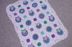 Purple/green crochet owl baby blanket.