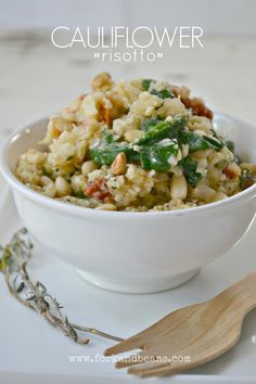 """Cauliflower """"risotto""""- www.forkandbeans.com  Interested to try this. I love risotto, but eating a whole bowl of white rice on a regular basis isn't really a good idea. Would be nice to have a healthier alternative!"""