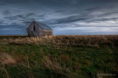 """Old barn on the Tantramar Marsh in Sackville, photo by Troy Johnstone (troyjohnstone.com).    An excerpt from Charles G.D. Roberts' """"Tantramar Revisited"""", which epitomizes how I feel about Sackville. (http://rpo.library.utoronto.ca/poem/1726.html)  Yet will I stay my steps and not go down to the marshland, --  Muse and recall far off, rather remember than see, --  Lest on too close sight I miss the darling illusion,  Spy at their task even here the hands of chance and change."""