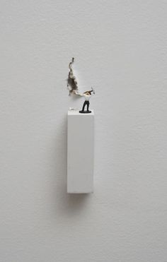 Forced Labor (man with pickaxe) (2008), , Figurine on wooden base and cracked wall