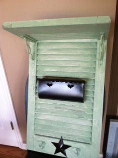 Repurposed shutter with mailbox and hooks