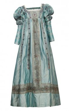 Lucrezia Borgia, played by Holliday Grainger wears a sky blue embroidered gown in Season 2 of The Borgias during the baptism of her son, Giovanni. Includes the sleeves later added to the gown.