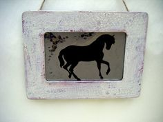 Prancing Horse silhouette antiqued mirror in distressed and crackled wood frame. The perfect wall accent for the horse lover. Compliment your home with this unique handmade antiqued mirror.