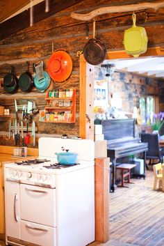 """Another pinner says, """"Kitchen inspiration. love the stove and cast iron pans."""" [And the piano someone can play sweetly while I cook.]"""