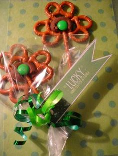 Easy St. Patrick's day craft for kids-- place 3 pretzels in a shamrock shape.  Top with a Hershey's kiss and bake at 350 for 3 minutes, until chocolate is soft. Press a green M&M into the chocolate.  What a cute treat-- and fun for kids to make!