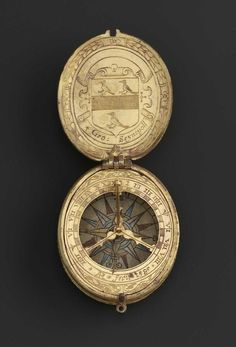 An Elizabethan gilded pocket sundial by Augustine Ryther.    Dated 1585     Made for Sir George St Paul, a Lincolnshire squire.