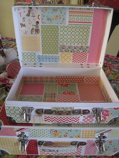 modpodge, old suitcases (old school breifcases would work too), a pad of cordinating scrapbook paper and white paint!