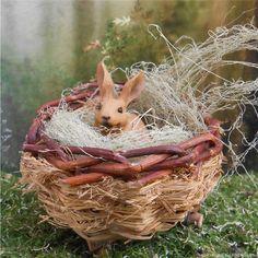 A mini brown rabbit to hop through your fairy gardens.