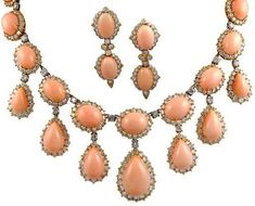 Van Cleef & Arpels angel skin coral and diamond necklace and earrings.  USA.  1970. Listing via 1stdibs.
