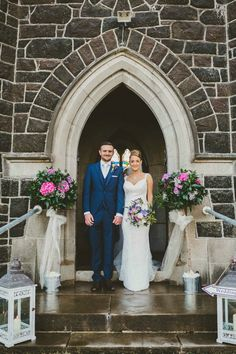 Outside church topiary trees and lanterns by The Posy Barn pic by Emma Kenny Photography